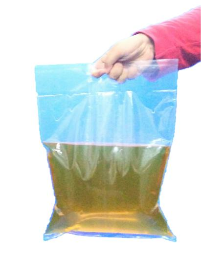 3kg Oil Laminated Center Flat Seal Bag with Punch Two Holes Handle .jpg